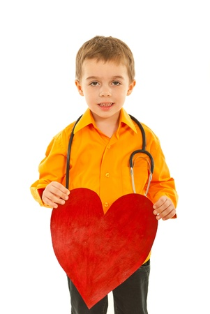 Future doctor boy holding heart shape isolated on white background photo