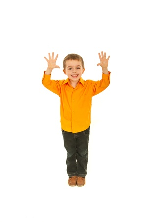 Joyful kid boy showing ten fingers isolated on white background photo