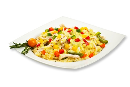Full plateau with chicken rice and vegetables decorated with rosemary leaves Stock Photo - 12596792
