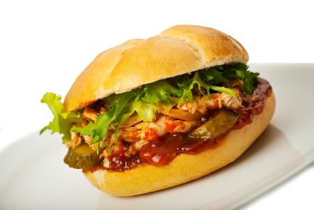 sanwich: Close up of sandwich with chicken and vegetables