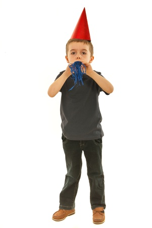 side profile: Full length of party boy blowing noise maker isolated on white background Stock Photo
