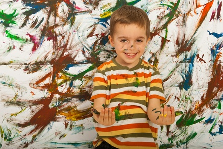 Messy child boy having fun  against painted background Stock Photo - 12596832