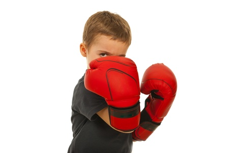 boy boxing: Defending little boy with boxing gloves isolated on white background