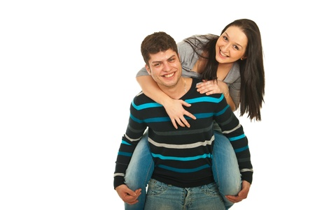 piggy back: Happy man giving piggy back to his girlfriends and having fun together isolated on white background Stock Photo