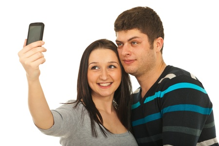 Young couple taking photo with their phone mobile isolated on white background photo