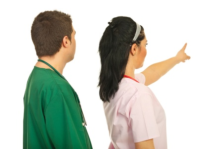 Back of two doctors pointing and looking to background copy space