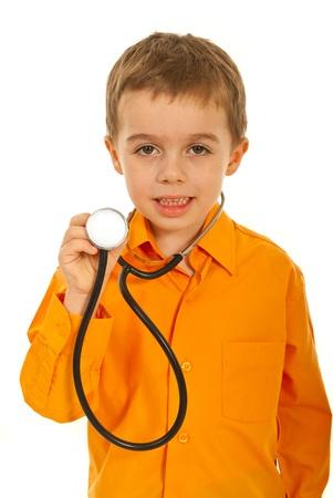 Little future doctor boy showing stethoscope isolated on white background photo