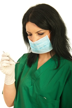 Close up of dentist woman holding mirror dental tool isolated on white background Stock Photo