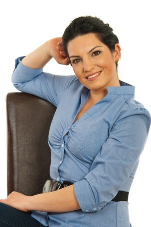 Happy businesswoman sitting on chair and holding hand to head isolated on white background photo