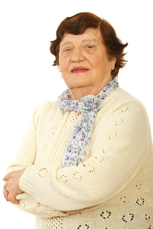 Smiling senior woman standing with arms folded isolated on white background photo