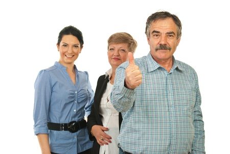 Mature business man giving thumb up in front of his team isolated on white background photo