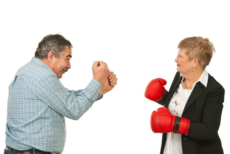 Two mature business people having confrontation isolated on white background photo