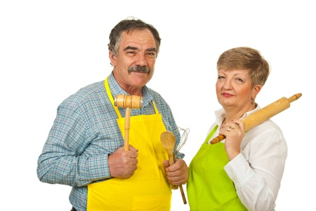 Mature couple holding kitchen utensil isolated on whiite background photo
