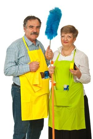 cleaning team: La gente mayor equipo de limpieza de la celebraci�n de productos de limpieza aislados sobre fondo blanco Foto de archivo