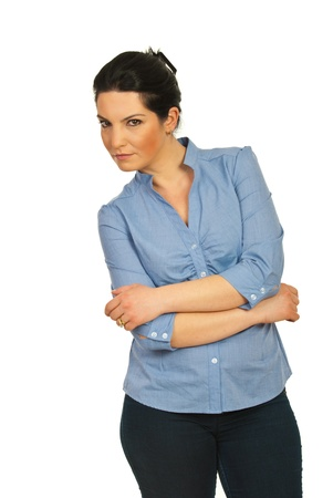 suspicious: Business woman standing with arms folded and looking suspicious isolated on white background