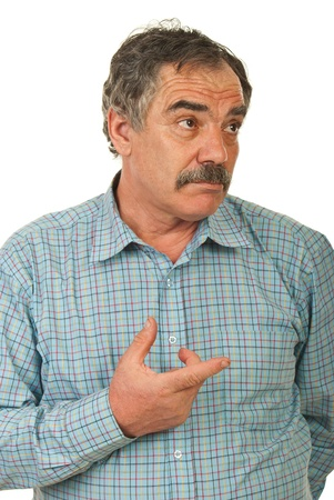 Mature business man thinking and being confuse pointing to a side isolated on white background Stock Photo - 12922623