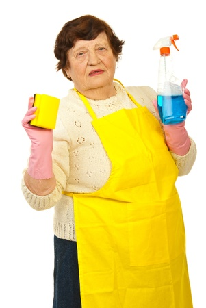Elderly woman showing cleaning products isolated on white background photo
