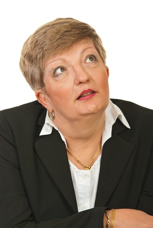 Amazed mature executive woman looking away isolated on white background photo