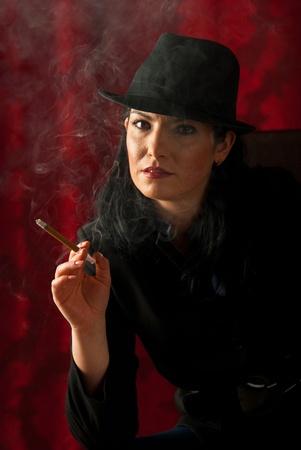 cigar smoking woman: Retro woman smoking long cigar  in the night Stock Photo