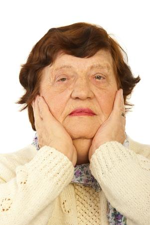 Sad grandma holding hands on cheeks isolated onw hite background photo