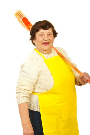 Laughing elderly woman carrying broom on shoulder isolated on white background Stock Photo - 12922354