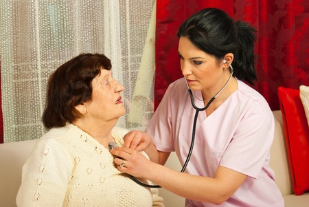 Doctor woman examine senior patient woman home Stock Photo - 12922329