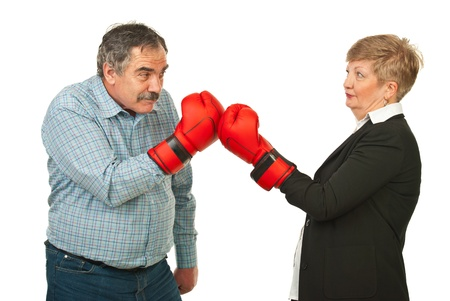 Mature business people having competition and fighting with boxing gloves isolated on white background photo