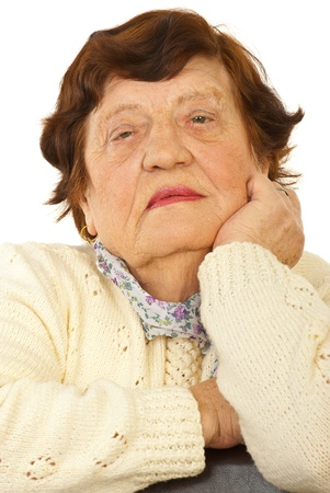 Close up of serious elderl face isolated on white background photo