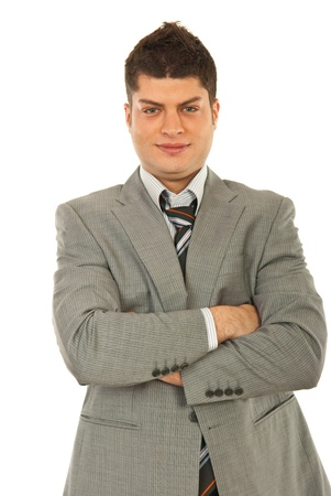 folded hands: Happy young business man in grey suit isolated on white background