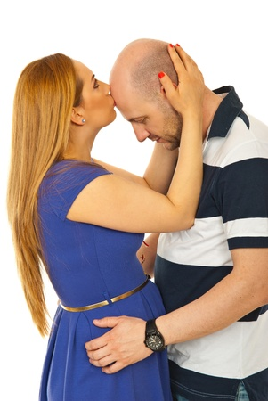 forehead: Woman kissing bald man forehead isolated on white background Stock Photo