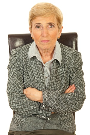 Senior executive woman sitting on chair isolated on white background photo
