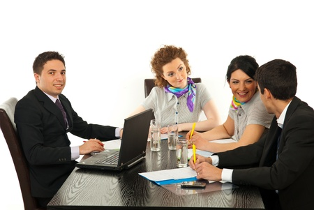 Business people having conversation at meeting  in office and one business man smiling to camera photo