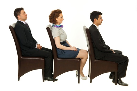 see side: Line of three business people sitting on chairs in profile isolated on white background Stock Photo