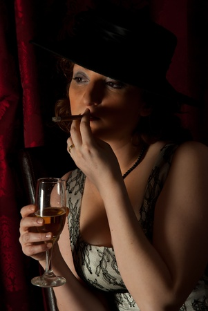 Beauty woman smoking in night and holding glass with champagne  photo
