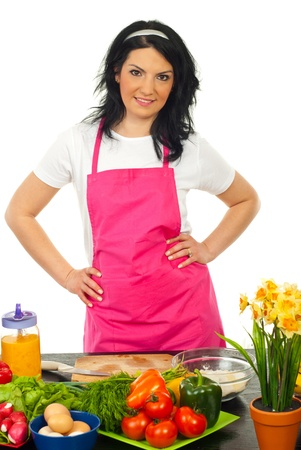 Smiling woman in kitchen standing with hands on waist against white background Stock Photo - 13105648