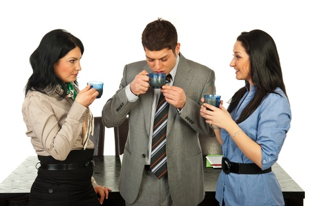 Three business people having coffee break in their office photo