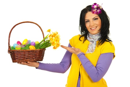 Spring woman showing Easter basket isolated on white background Stock Photo - 13105609