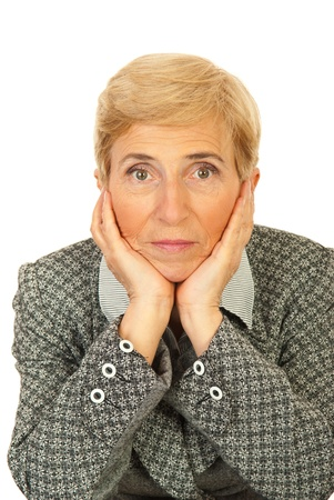 Sad senior business woman resting face in hands on chair seat isolated on white background photo