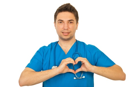 Doctor male showing heart shape isolated on white background Stock Photo - 13105222