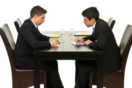 Two business men writing and discuss in office photo