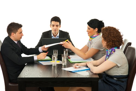 four person: Four coworkers having cnversation and giving contract at meeting