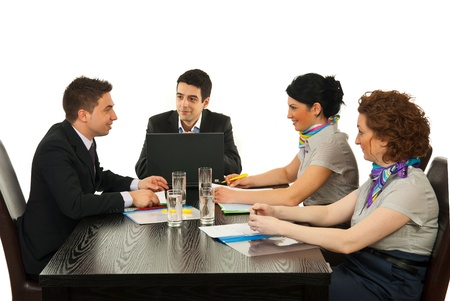 Businesspeople having happy conversation at meeting against white background photo