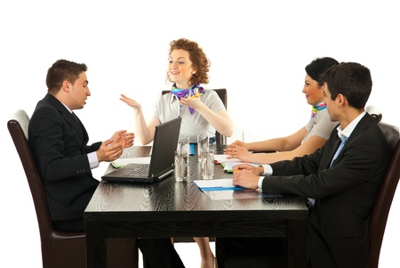 Business woman having conversation with business man at meeting photo