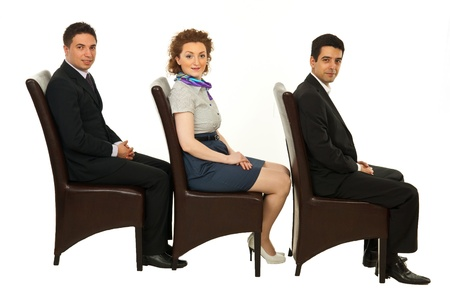 Waiting business people on chairs looking at camera isolated on white background photo
