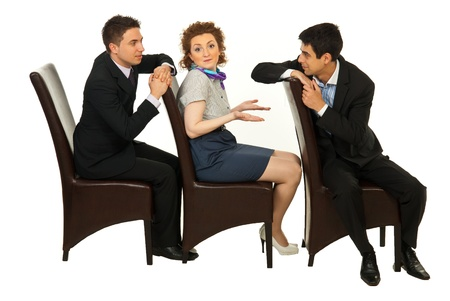 Confused business woman between two business men discussion sitting on chairs in a row photo