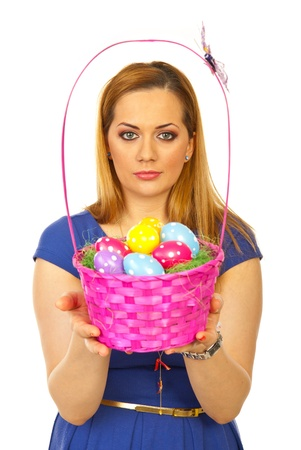 Beautiful easter blond woman holding colorful basket with egss isolated on white background Stock Photo - 13202910