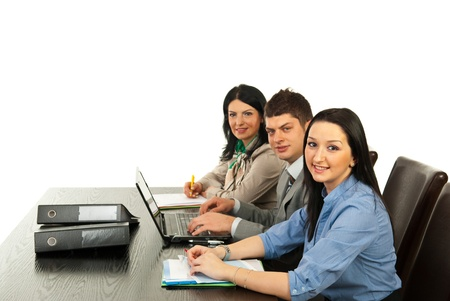 Cheerful business people sitting at table in row in their office Stock Photo - 13202897