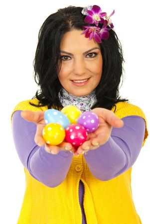 Beauty spring woman giving you colorful Easter eggs isolated on white background photo