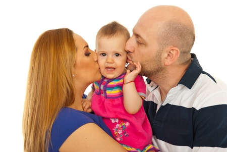 Mother and father kissing amazed baby girl isolated on white background photo