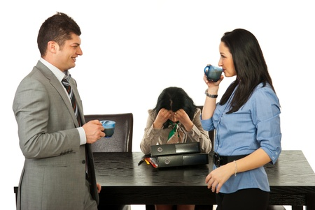 Two people drinking coffee in a break and other business woman being upset and sitting at table